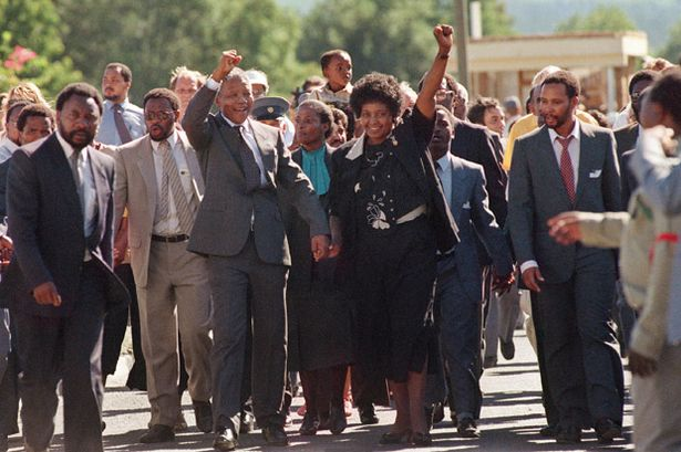 1990-Nelson-Mandela-and-his-then-wife-Winnie-raising-their-fists-and-saluting-cheering-crowd-upon-Mandelas-release-from-745759