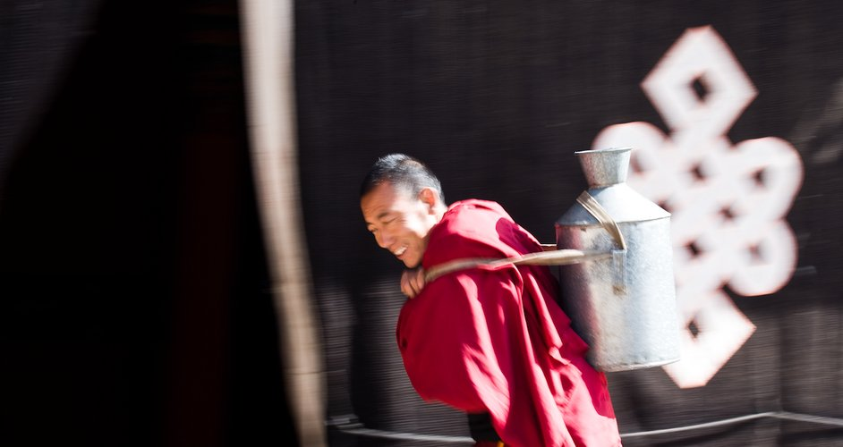 monk-carrying-water